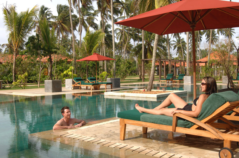 Couple Relaxing by the Swimming Pool