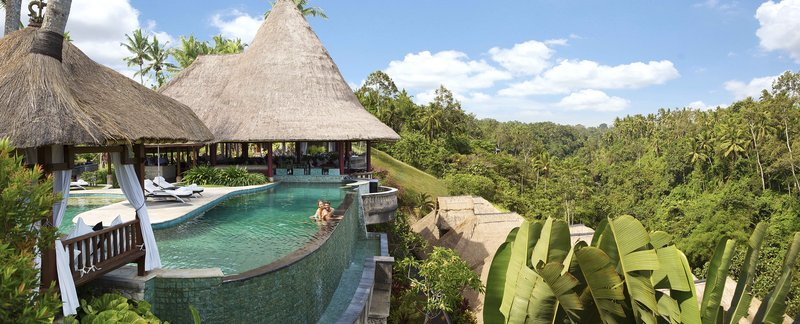 Pool overlooking rich tropical landscape
