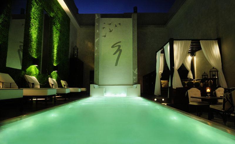 Illuminated heated pool and cascade