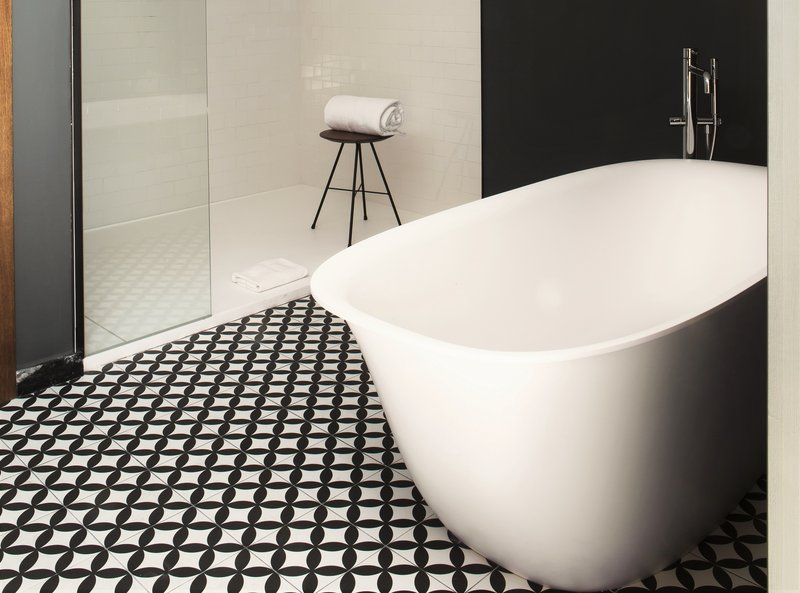 Deluxe Atico bathroom with freestanding bathtub