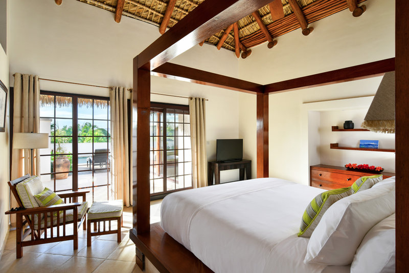King Suite bedroom overlooking the pool