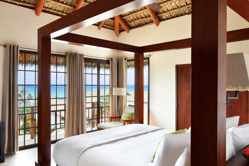 The king suite bedroom in the 3-bed villas