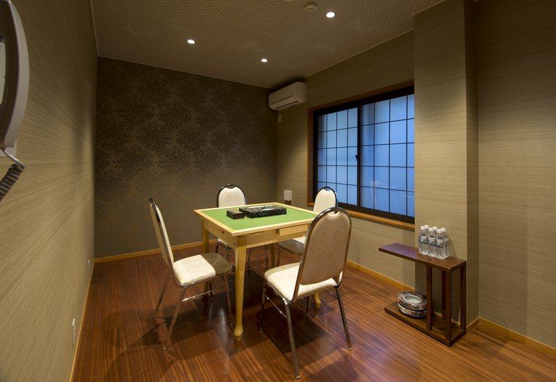 A recreation room with Mahjong tables