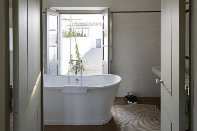 Free-standing bathtub highlights bathroom's suites