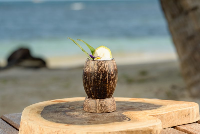 Calala cocktail in a hand-carved coconut cup