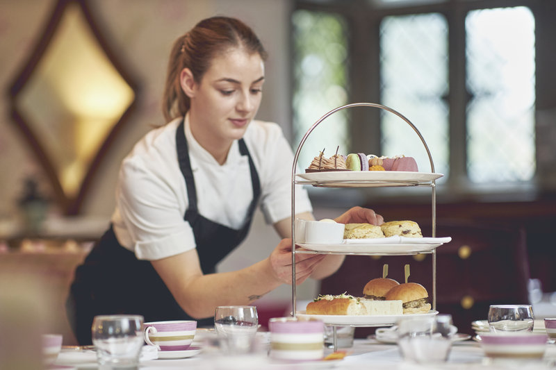 Pastry Chef putting the finishing touches to Afternoon Tea