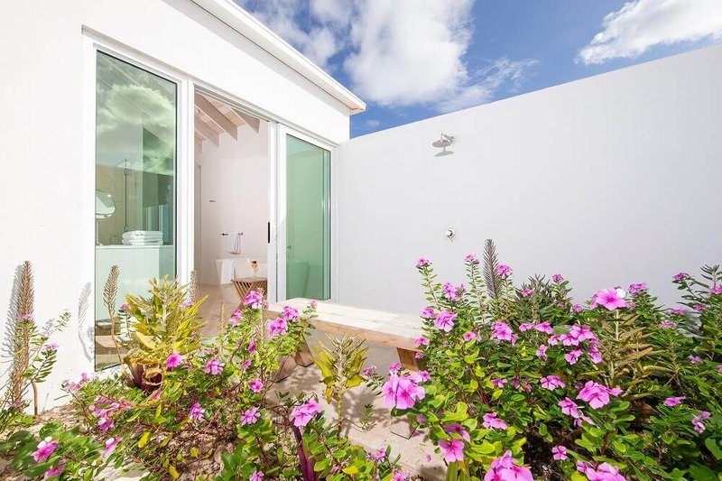 One Bedroom Beachfront Villa Outdoor Shower Garden