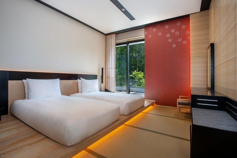 Deluxe Corner Suite Bedroom